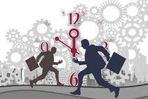 Auf dem Bild ist zu sehen, dass Arbeitnehmer häufig Zeitstress haben. Um Konzentrationsfähig zu bleiben ist die Einhaltung der vorgeschriebenen Pausen im Gesetz zur Arbeitszeit sehr wichtig.